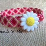 Friendship Bracelet - red diamond wif flower button